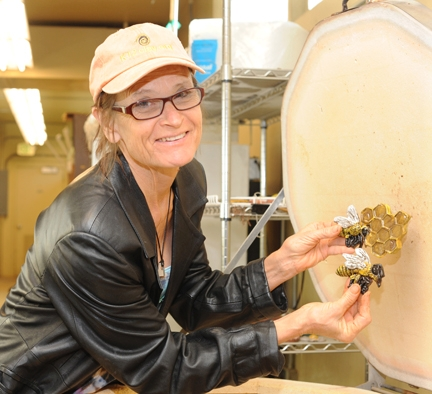 Artist Donna Billick, co-founder and co-director of the UC Davis Art/Science Fusion Program, with some of the ceramic art for the .Häagen-Dazs Honey Bee Haven. (Photo by Kathy Keatley Garvey)