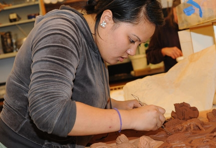 UC Davis honors student Christine Santa Maria works with the clay.