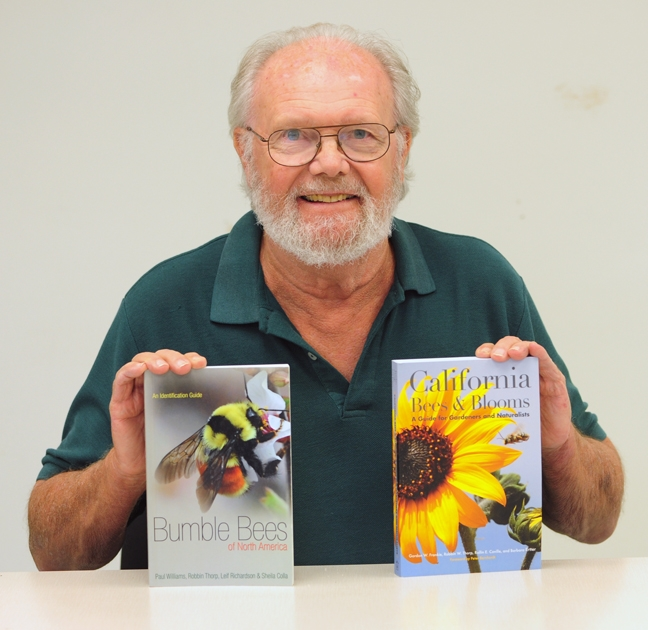 Native pollination specialist Robbin Thorp with two  books he co-authored this year. Both are available in the Bohart Museum of Entomology. (Photo by Kathy Keatley Garvey)