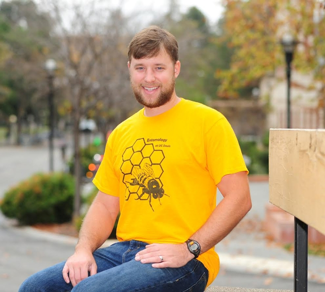 Danny Klittich, outside Briggs Hall, UC Davis. He is wearing the bee shirt he designed that won the EGSA contest. (Photo by Kathy Keatley Garvey)
