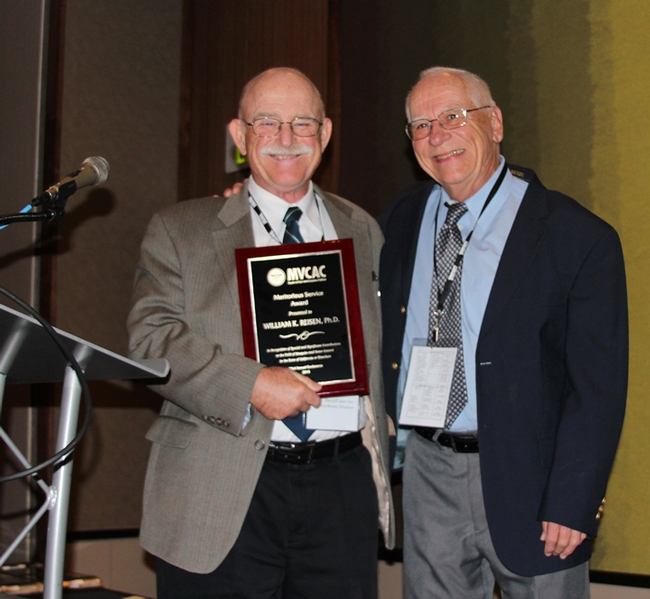 Medical entomologist/emeritus professor William Reisen (left) receives the 2015 Meritorious Award for Service from MVCAC. Making the presentation: medical entomologist Bruce Eldridge, emeritus professor, UC Davis Department of Entomology and Nematology. Eldridge received the award in 1997. (Photo by Jill Oviatt, courtesy of MVCAC)