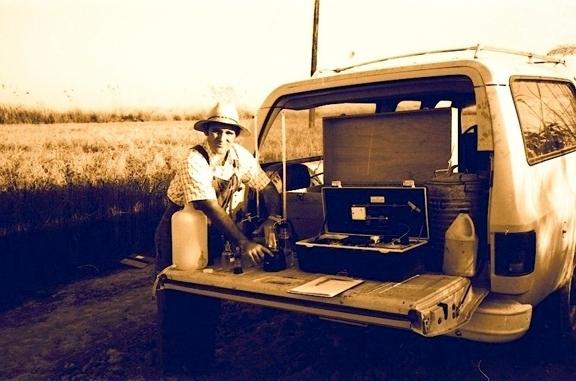 Medical entomologist William Reisen water-testing mosquito habitats near Lahore, Pakistan in 1976.
