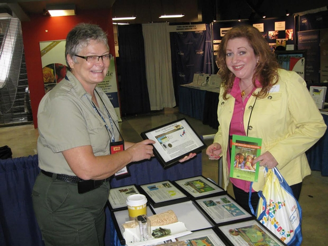 Cheryle O'Donnell (left) answers an entomology question at the  2012 Orchid Show, held at the Miami-Dade Fairgrounds, Florida.