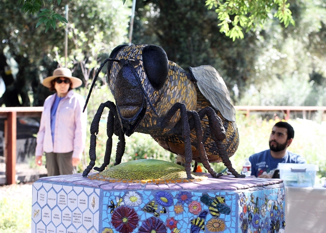 Miss Bee Haven, a mosaic ceramic of a worker bee by artist Donna Billick, anchors the bee haven. It was funded by Wells Fargo.(Photo by Kathy Keatley Garvey)