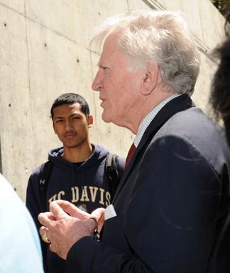 UC Davis student Shaun Miller listens to Sen. Gary Hart.