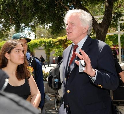 UC Davis student Anna Misra talks to Sen. Gary Hart.