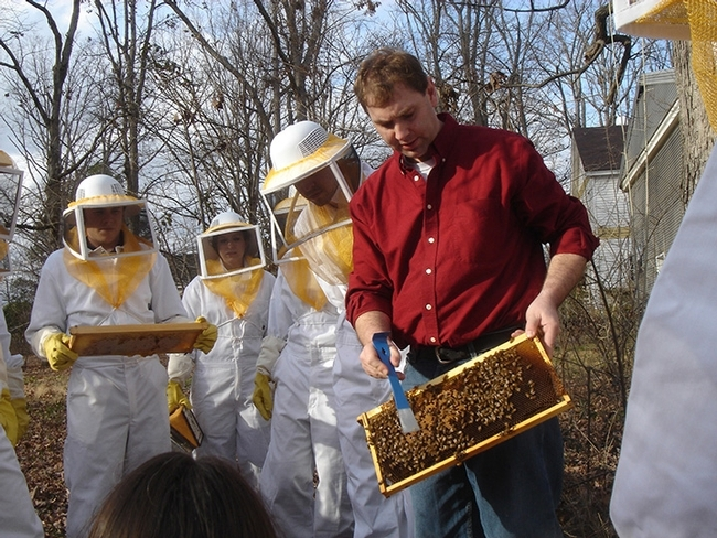 David Tarpy (at right, in red) with beekeeping students. (Photo courtesy of North Carolina State University)