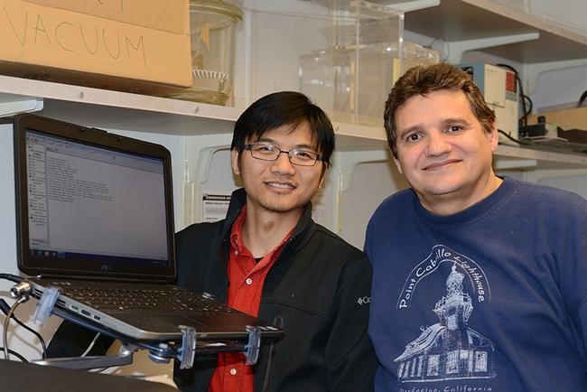 Researchers Jun Yang (left) and Christophe Morisseau of the Hammock lab. (Photo by Kathy Keatley Garvey)