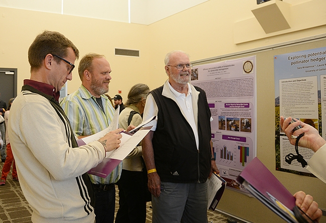 Judges were (from left) Quinn McFrederick, assistant professor of entomology, UC Riverside; Dennis vanEnglesdorp, professor of entomology, University of Maryland, College Park; and Robbin Thorp, distinguished emeritus professor of entomology, UC Davis. (Photo by Kathy Keatley Garvey)