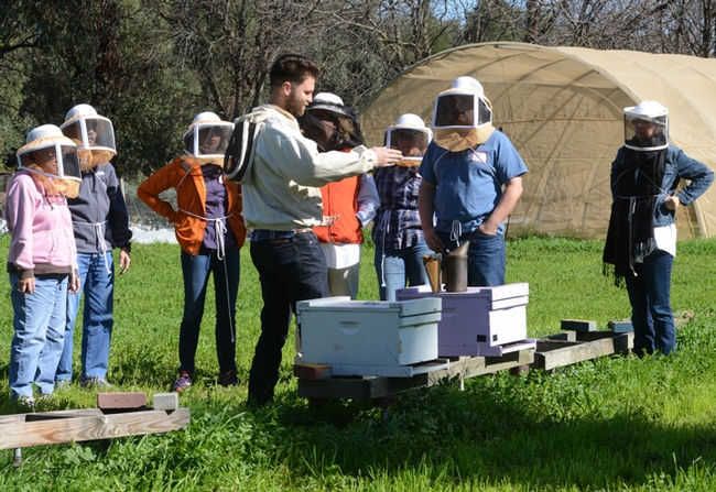 Beekeeper/beekeeping instructor Charley Nye, manager of the Harry H. Laidlaw Jr. Honey Bee Research Facility, teaching a class in February. (Photo by Kathy Keatley Garvey)