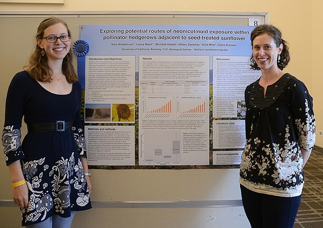 Sara Winsemius (left) and Laura Ward, UC Berkeley graduate students, shared the $1000 prize as first-place winners of the UC Davis Bee Symposium Graduate Student Poster Competition. (Photo by Kathy Keatley Garvey)