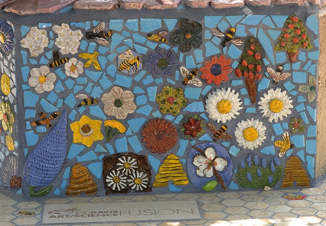 Flowers and insects intermingle in  the Häagen-Dazs Honey Bee Haven's ceramic-mosaic sculpture. (Photo by Kathy Keatley Garvey)