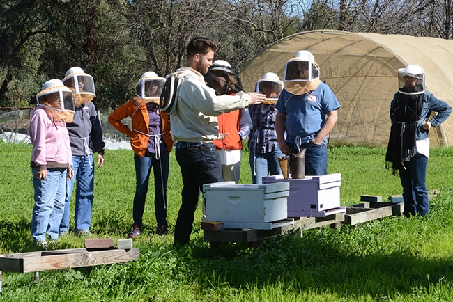 Charley Nye (center) explains the basics of beekeeping to a recent class at the Laidlaw facility. (Photo by Kathy Keatley Garvey)