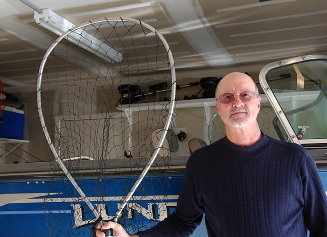 Les Ehler is switching from an insect net to a fishing net. (Photo by Kathy Keatley Garvey)