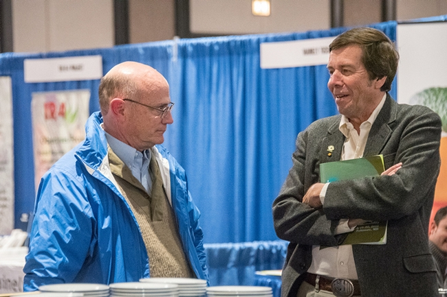 Lifetime achievement award winners Pete Goodell (left) and Frank Zalom discuss IPM projects. (Photo by Lena McBean, Remsberg Inc.)