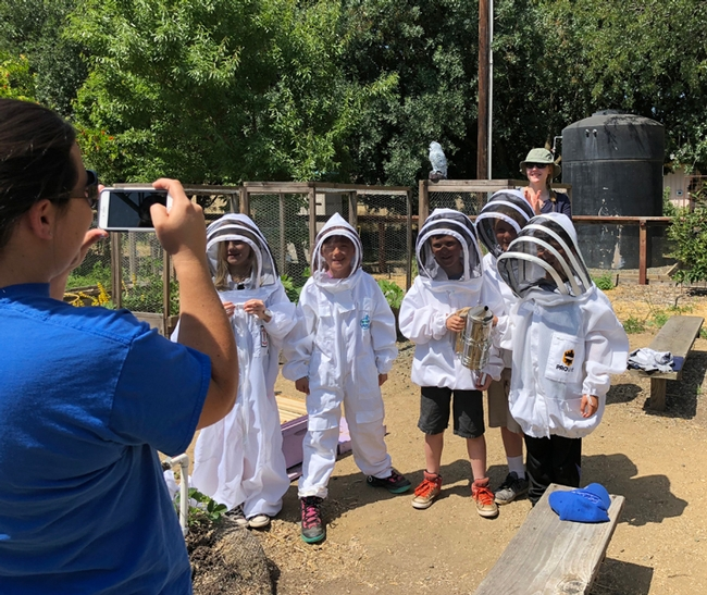 The Amador County third graders, wearing bee suits, pose for a photo. (Photo by Kathy Keatley Garvey)