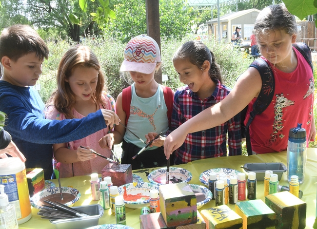 At this activity station, students learned about native bees and painted nest boxes. (Photo by Kathy Keatley Garvey)