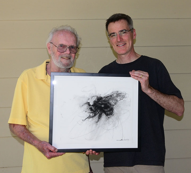 Professor Neal Williams (right) with Robbin Thorp, distinguished emeritus professor of entomology, with a prized illustration of Franklin's bumble bee, a gift at the PBESA meeting. It is the work of Portland, Ore. artist Coppini. (Photo by Kathy Keatley Garvey)