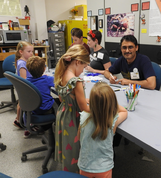 Entomologist Syed Fahad Shah, shown here Sept. 21 at the Bohart Museum open house, was robbed at gunpoint on Sept. 20. Next to him is doctoral candidate Charlotte Herbert Alberts.(Photo by Kathy Keatley Garvey)