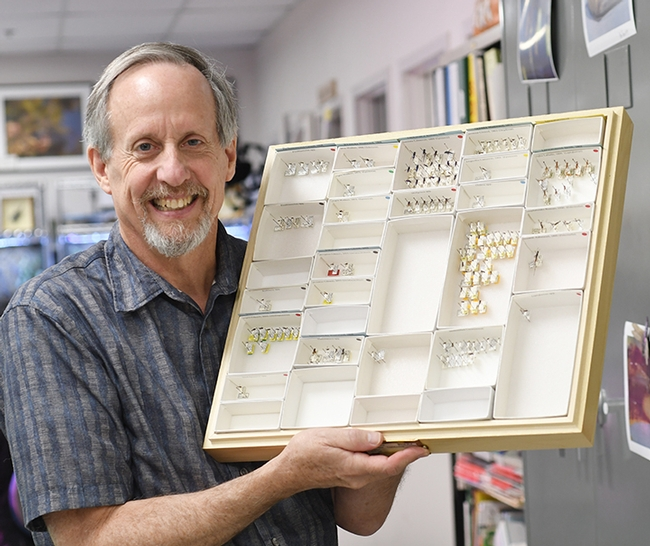 Senior museum scientist Steve Heydon with part of his collection of Pteromalids or jewel wasps. (Photo by Kathy Keatley Garvey)