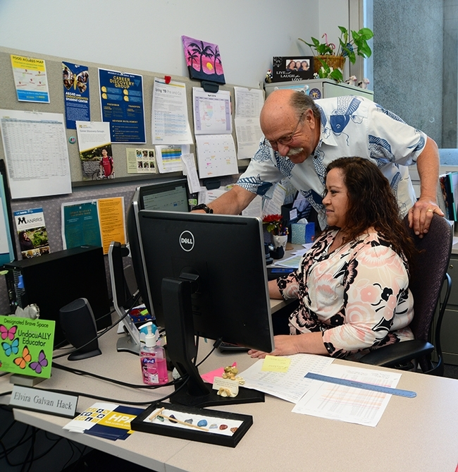UC Davis animal biology major master advisor Robert Kimsey and  advisor Elvira Galvan Hack confer on an advising plan. Both won regional advising awards from NACADA, the Global Community for Academic Advising.(Photo by Kathy Keatley Garvey)