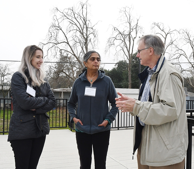 Extension apiculturist (emeritus) Eric Mussen chats with USDA-ARS researchers Julia Fine (left) and Arathi Seshadri. (Photo by Kathy Keatley Garvey)