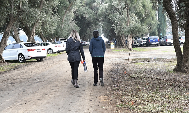 At the end of the ceremony, research entomologists Julia Fine (left) and Arathi Seshadri walk to the stakeholders' meeting at the Laidlaw facility. (Photo by Kathy Keatley Garvey)