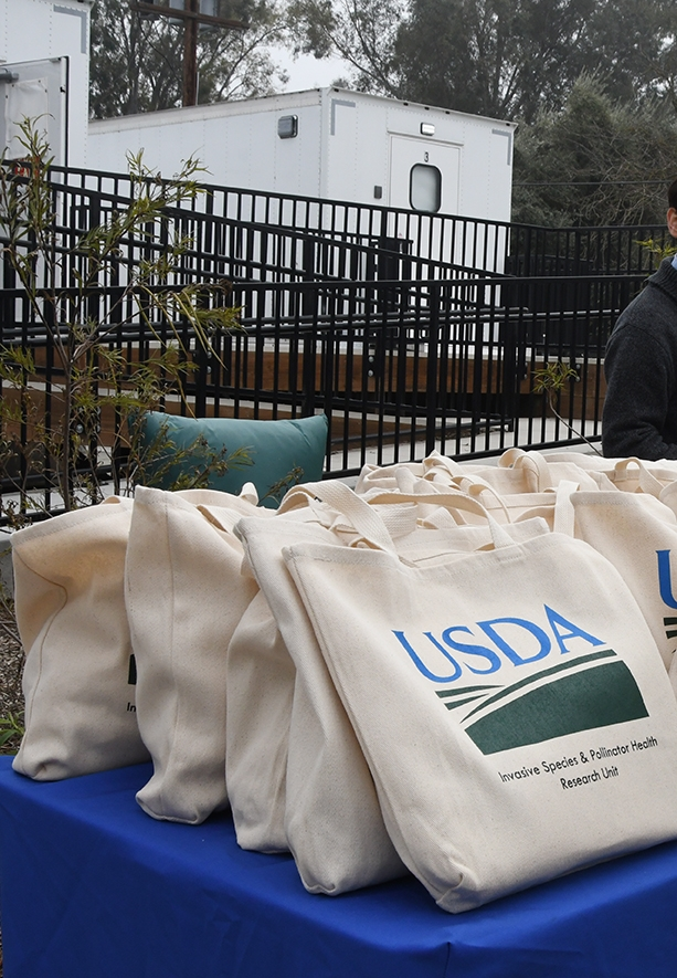 USDA tote bags awaiting the special guests. (Photo by Kathy Keatley Garvey)