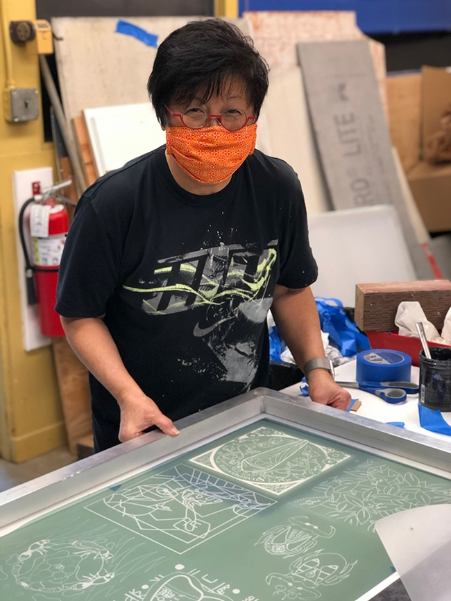 Designer-lecturer Gale Okumura of the UC Davis Department of Design engaged in printing.