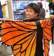 RJ Millena portrays a monarch at the Bohart Museum of Entomology's Halloween party.