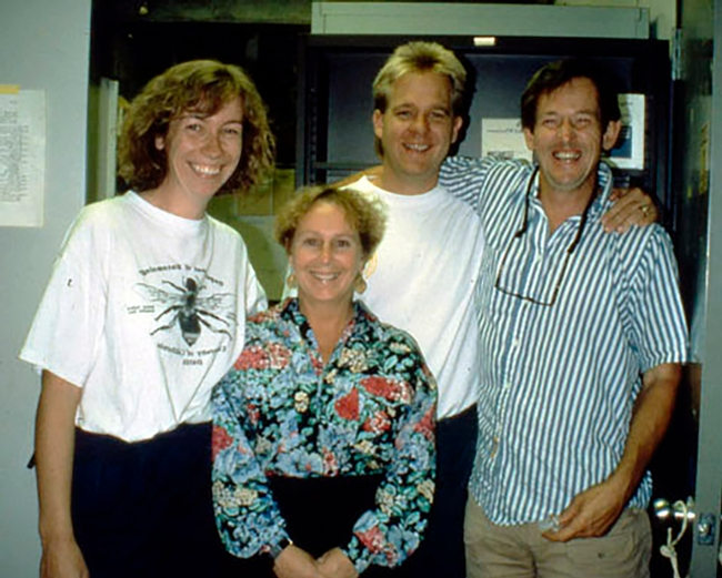 This image from 1993 at UC Davis shows Kelli Hoover (foreground), then a doctoral student. In back (from left) are doctoral students Bryony Bonning and Bill McCutcheon, and Professor Sean Duffey.