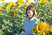 Rachael Long takes notes on sunflower seed production.