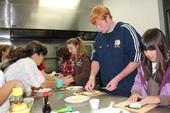 4-H participants learn to make sushi. The public health report says 53% of Huntington Park youth are overweight. Alston says federal farm subsidies have little effect on obesity.