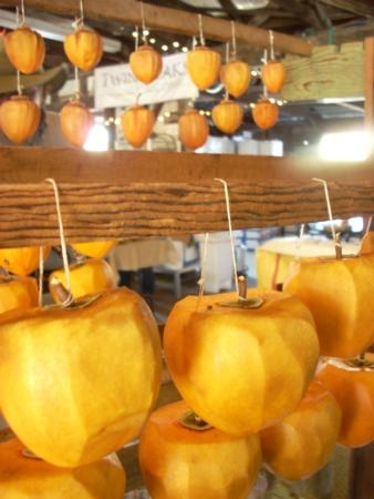 Drying whole Hachiya persimmons.