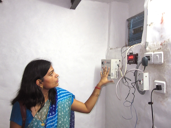 Neeru Dubey, of Amity University, shows a CoolBot installed in India during a Horticulture CRSP project.