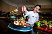 Celebrity chef Martin Yan puts the finishing touch on a Chinese dish.