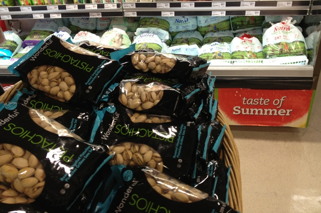 A Toronto grocery market sells California pistachios and milk in bags.