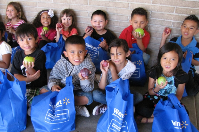Kids enjoying fresh fruit at Roosevelt Elementary School.