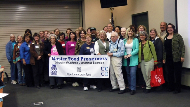 Participants line up for a group photo at the first-ever Master Food Preserver conference.