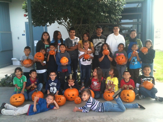 UC nutrition educator Grilda Gomez, back row far right, poses with the students and their jack-o-lanterns.