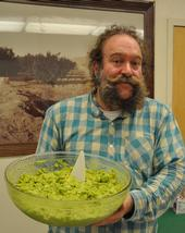 Eric Focht shows the guacamole he prepares for an avocado tasting at UC Riverside.