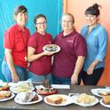 Julianna Payne's cupcakes were a big hit at the Solano County Fair. From left are Gloria Gonzalez, superintendent of McCormack Hall; Julianna Payne; Sharon Payne, assistant superintendent; and Angelica Gonzalez, staff. (Photo by Kathy Keatley Garvey).