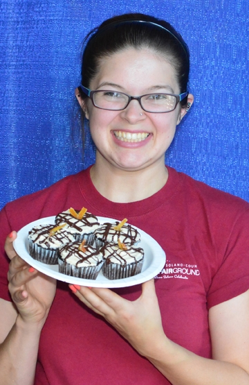 Julianna Payne with her gluten-free cupcakes. (Photo by Kathy Keatley Garvey)