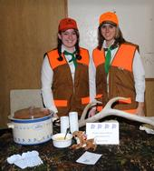 Lauren Kett (left) and Rebecca Ivanusich of the Maine Prairie 4-H Club, Dixon, dressed as hunters and served
