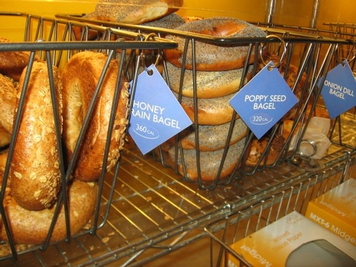 Restaurant bagel labels with calorie counts.