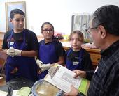 Evaluator John Vasquez Jr., (right foreground) talks to the Lil' Peppers. From left are  Elijah and Maleah Desmarais, and Jessie Means. (Photo by Kathy Keatley Garvey)