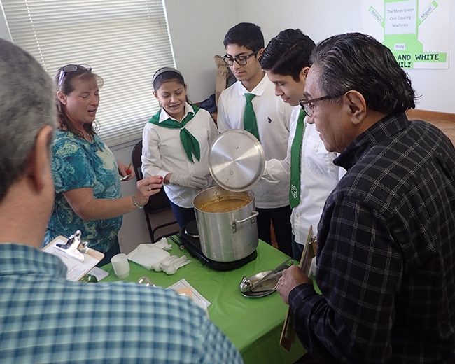 Chili Cook-Off Cooordinator Connie Reed (far left) of the Sherwood Forest 4-H Club, Vallejo,  tests the temperature of the chili. From left are the Mean Green Chili Cooking Machines of the Dixon Ridge 4-H Club: Maritiza Partida Cisneros, Rudy Cisneros Radillo and Miguel Partida Cisneros. At far right is evaluator Solano County Supervisor John Vasquez Jr. (Photo by Kathy Keatley Garvey)