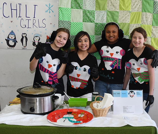 The Chili Girls of the Sherwood Forest 4-H Club, Vallejo, dressed as penguins, await the judges. From left are Julietta Wynholds, Selah Deuz, Celeste Harrison and Hanna Stephens. (Photo by Kathy Keatley Garvey)