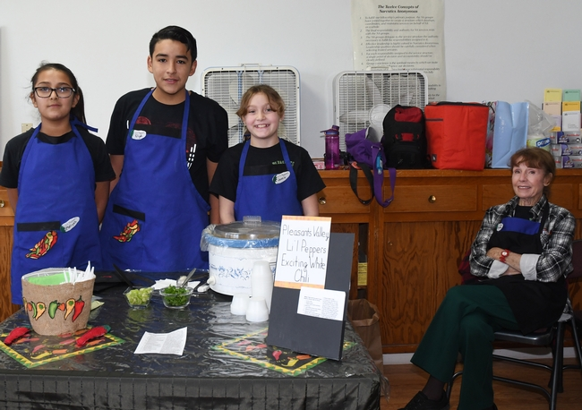 The winning team, the Lil' Peppers from the Pleasants Valley 4-H Club, Vacaville. From left are Maleah and Elijah Desmarais and Jessie Means. At far right is their advisor, Marlene Means. (Photo by Kathy Keatley Garvey)