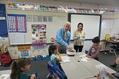 U.S. Congressman Jim Costa blends a salad for students at La Vina Elementary School in Madera County. UCCE nutrition educator Angelica Perez stands with the congressman.
